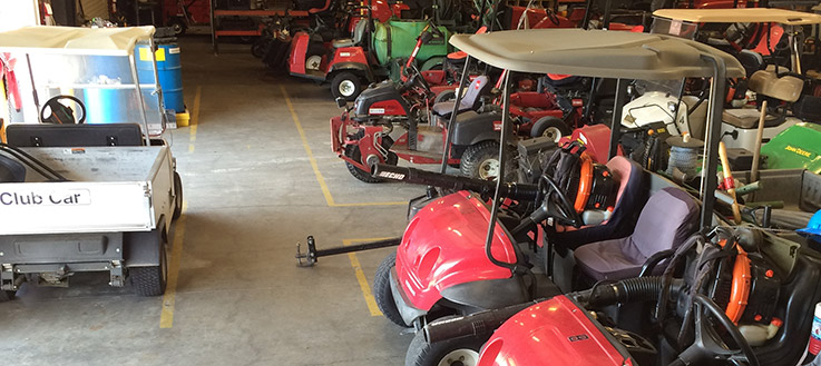 golf course maintenance equipment lined up