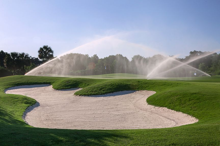 sprinklers watering a golf course