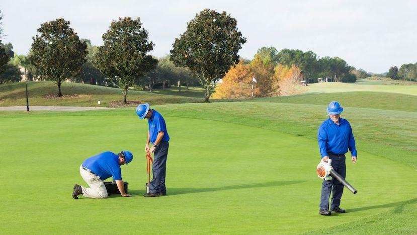 golf course maintenance crew collecting soil sample