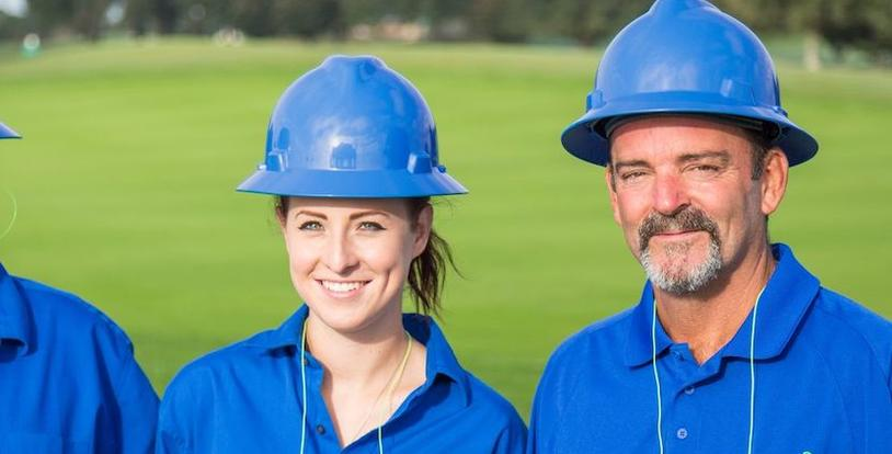 female and male golf course maintenance crew members